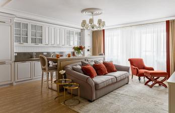 Светлая кухня с диваном и креслом