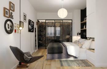 Спальня с кроватью и телевизором