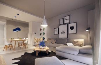 Гостиная-в-серых-тонах-с-большим-диваном-и-картинами