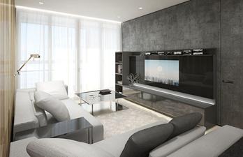 Светлая гостиная с диванами и телевизором