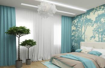 Спальня в голубых тонах с большой кроватью