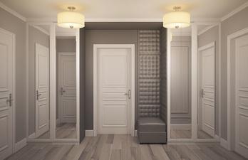 Прихожая в серых тонах со шкафами